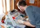 Dan Martin uses the Siemens arterial blood gas machine during the oxygen extraction study