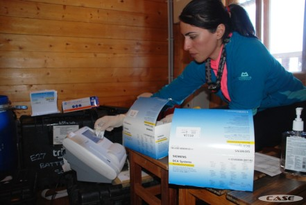 Maryam tests the urine using the DCA machine
